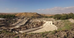 BEIT SHE'AN, ISRAEL (4K) - ascending aerial of ancient Roman amphitheater & city - stock footage