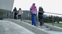 Four women are walking up the stairs to a safe driving center building Stock Footage