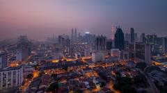 Timelapse Hazy Sunrise Kuala Lumpur Skyscrapers with Pan motion - stock footage