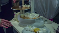 Taking small cakes off a plate Stock Footage