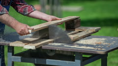 Cutting wood with circular saw - stock footage