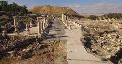 BEIT SHE'AN, ISRAEL (4K) - stunning aerial shot through ancient Roman pillars Stock Footage