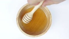 Wooden dipper of honey cup on top view Stock Footage