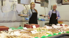 Portrait of two sellers in fish section Stock Footage