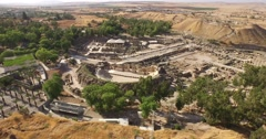 BEIT SHE'AN, ISRAEL - sweeping aerial of ancient Roman amphitheater & whole park Stock Footage