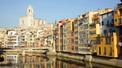 Picturesque homes on  river bank in Gerona Stock Footage