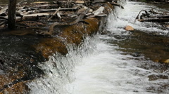 Ultra slow motion mountain river stream logs waterfall HD Stock Footage
