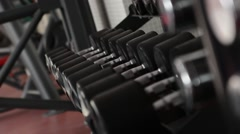 Dumbbell lying in a row. Floating focus - stock footage