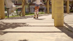 Young Woman Roller Skating on Sunny Promenade Stock Footage