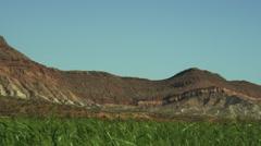 Green Fields Red Rock Stock Footage