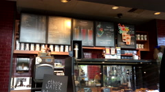 Motion of Starbucks menu on wall Stock Footage