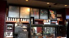 Motion of Starbucks menu on wall - stock footage