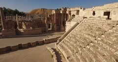 BEIT SHE'AN, ISRAEL (4K) - ascending aerial of ancient Roman city amphitheater Stock Footage