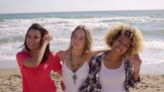 Three happy vivacious multiracial girl friends Stock Footage