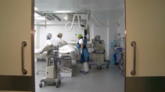 Two surgeons and a nurse doing heart surgery . Arkistovideo