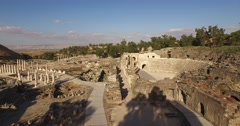 BEIT SHE'AN, ISRAEL (4K) - Stunning aerial over Roman city, amphitheater & cardo Stock Footage