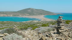 Mediterranean & Aegean seas separated by peninsula at Prasonisi Rhodes rock pile Stock Footage
