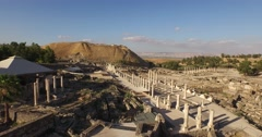 BEIT SHE'AN, ISRAEL (4K) - aerial pan shot of Roman city, amphitheater & cardo Stock Footage