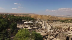 BEIT SHE'AN, ISRAEL (4K) - aerial pan Roman city, amphitheater & cardo Stock Footage