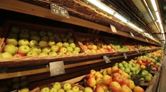 Showcases with apples and pineapples Stock Footage