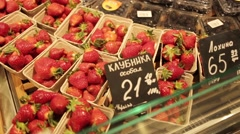 Showcases with strawberries, blueberries and black currants Stock Footage