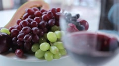 Composition with grapes, papaya, strawberries and a glass of wine Stock Footage