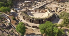 BEIT SHE'AN, ISRAEL (4K) - aerial view orbiting Roman city, amphitheater & cardo Stock Footage
