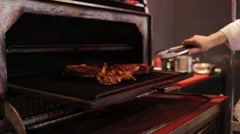 Cooking meat in Josper Stock Footage