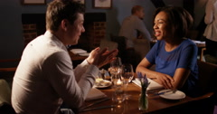 4K Mixed ethnicity couple on date in restaurant, getting to know each other Stock Footage