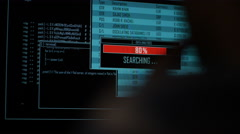4K Hacker accessing and searching data files at night in the dark Stock Footage