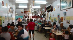 People eating at a local restaurant in Georgetown Penang Stock Footage