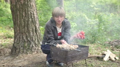 Woman prepares shashlik at the picnic. Stock Footage