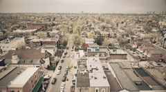 Establishing aerial shot of city. 4K filmic footage. Warm color grade. Stock Footage