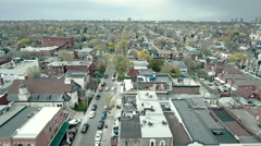 Establishing aerial shot of city neighborhood. 4K filmic footage. Stock Footage