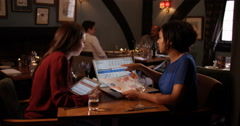 4K Young professional women have working lunch, discuss business in restaurant Stock Footage