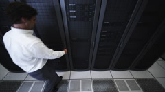 IT Guy Checks Rack Mounted Servers Stock Footage