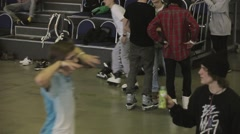 Young roller skaters give five to each other in skatepark. Preparing to contest - stock footage