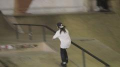Young female roller skater make horizontal slide on fence in skatepark. Contest Stock Footage