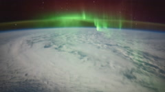 February: ISS panning view of Earth with Aurora Borealis over the South Sea Stock Footage