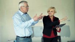 Mature couple with tablet fighting about new home project Stock Footage