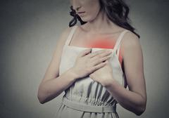 Woman with heart attack sudden pain, health problem holding touc Stock Photos