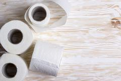 Toilet paper on wooden board - stock photo