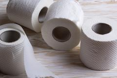 Toilet paper on wooden board Stock Photos