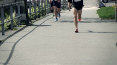 Professional joggers racing in marathon, super slow motion 240fps Stock Footage