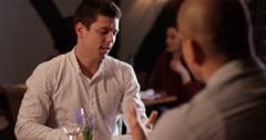4K 2 Men having serious disagreement in restaurant Stock Footage