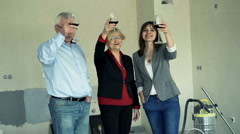 Portrait of happy family raising toast to camera at their new home - stock footage