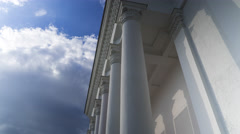Classical white colonnade against cloudy sky 4K time lapse Stock Footage