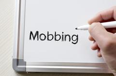 Mobbing written on whiteboard Stock Photos