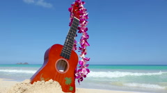 Vacation travel concept with ukulele and lei on tropical beach Oahu Hawaii - stock footage
