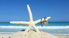 Love travel concept Wedding rings and starfish on tropical beach Oahu Hawaii - stock footage